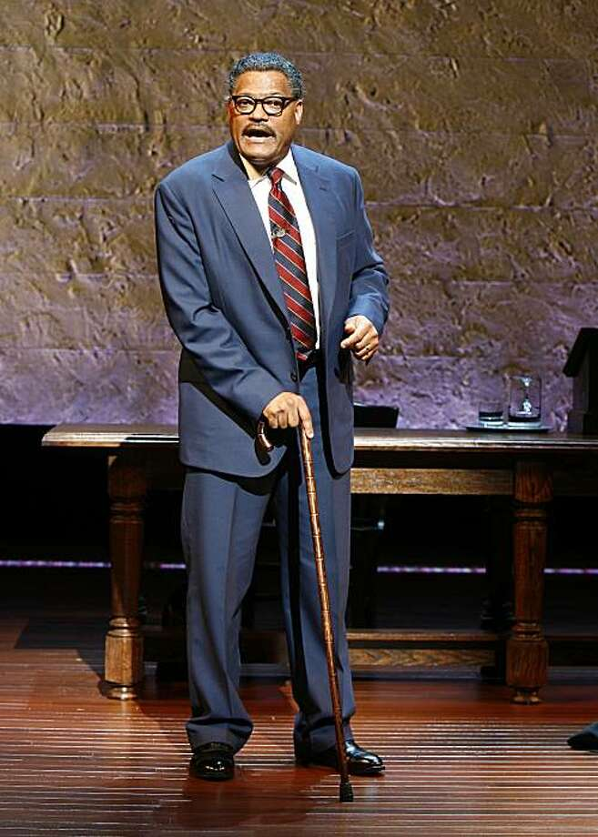 """** CORRECTS CAPTION TO CHANGE MARSHALL'S TITLE FROM CHIEF JUSTICE TO JUSTICE. ** In this image released by Fifteen Minutes PR, Laurence Fishburne is shown.  Fishburne appears in """"Thurgood,"""" a one-man play depicting the rise of Thurgood Marshall, who rose from a childhood in the back streets of Baltimore to become a  Justice of the United States Supreme Court. The play, written by George Stevens Jr., and directed by Leonard Foglia, opens April 30 at the Booth Theater in New York.  (AP Photo/Fifteen Minutes PR, Carol Rosegg)  ** NO SALES, MANDATORY CREDIT: Carol Rosegg ** Photo: Carol Rosegg, Fifteen Minutes PR Via AP"""