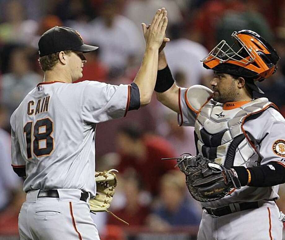 San Francisco Giants catcher Bengie Molina congratulates starting pitcher Matt Cain (18) after the Giants defeated the Cincinnati Reds 3-0 in a baseball game Tuesday, June 8, 2010, in Cincinnati. Cain threw a seven-hitter and drove in a run with a single. Photo: Al Behrman, AP