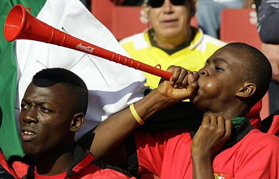 A Nigerian supporter blows a vuvuzela prior to the World Cup group B soccer match between Argentina and Nigeria at Ellis Park Stadium in Johannesburg, South Africa, on Saturday, June 12, 2010. Photo: Rick Bowmer, AP