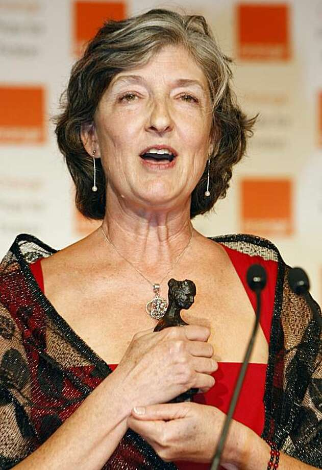 "Winner of the 2010 Orange Prize for Fiction Barbara Kingsolver, reacts after receiving her award from Camilla, Duchess of Cornwall, unseen, at the award ceremony in London Wednesday, June, 9, 2010. American novelist Barbara Kingsolver took home the prestigious Orange Prize for Fiction on Wednesday with her sixth novel ""The Lacuna,"" beating bookmakers' favorite Hilary Mantel. Photo: Alastair Grant, AP"