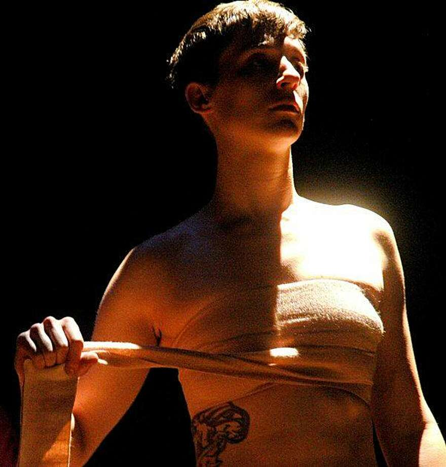 "Dylan (Kathryn Zdan), a young transgender man, unbinds his breasts while looking in a mirror in Enrique Urueta's ""Forever Never Comes"" Photo: Dave Nowakowski"