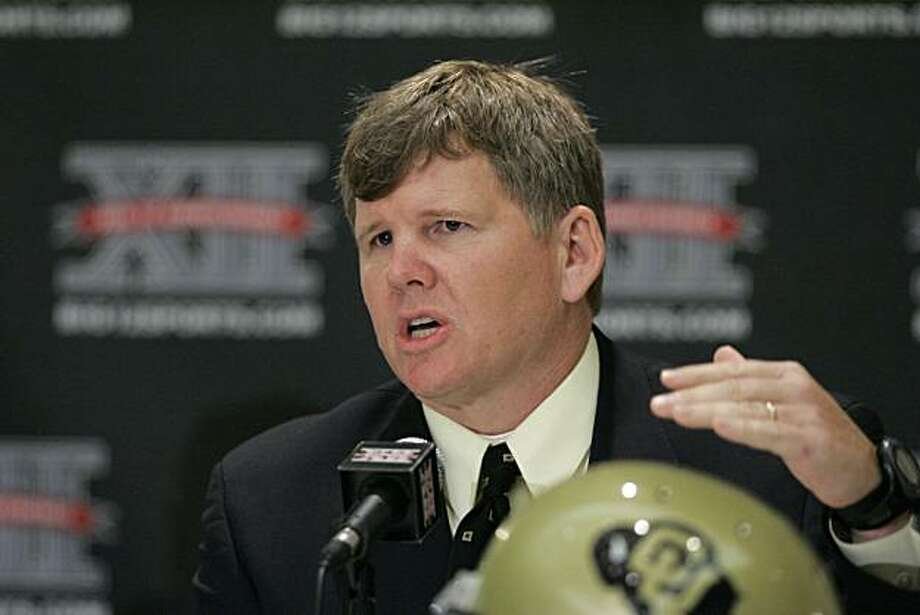 FILE - This July 29, 2009, file photo shows Colorado football coach Dan Hawkins gesturing at a news conference during Big 12 Media Day in Irving, Texas. The Pac-10 conference says Colorado has accepted an invitation to become the league's 11th member.  The conference announced its first expansion since adding Arizona and Arizona State in 1978 on Thursday, June 10, 2010. Photo: Donna McWilliam, AP