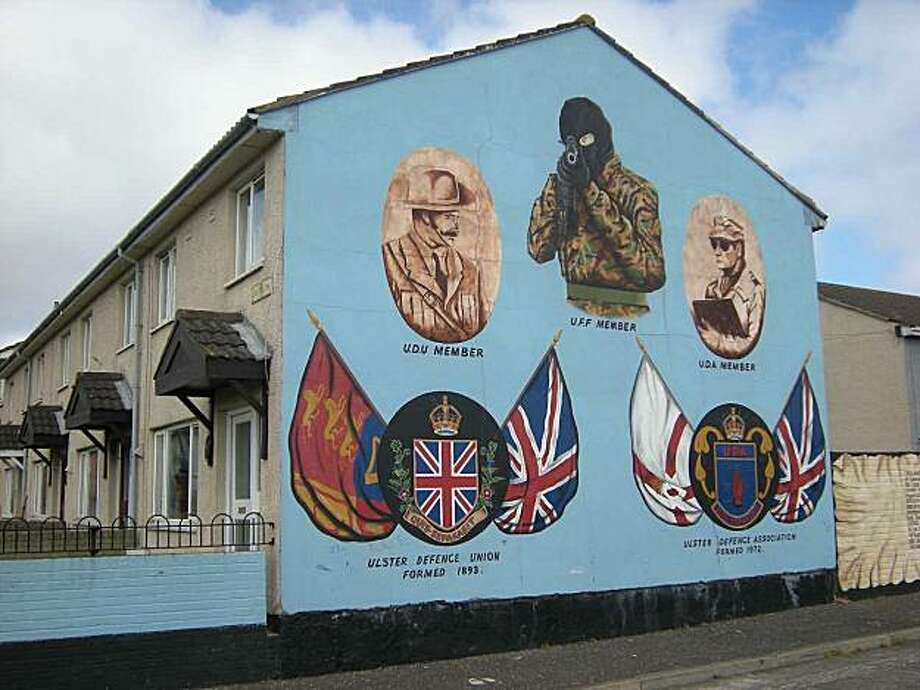 """Murals in Belfast are among the highlights of the popular """"black taxi"""" tours of the embattled city. Photo: Steven Slon, Hearst Newspapers"""