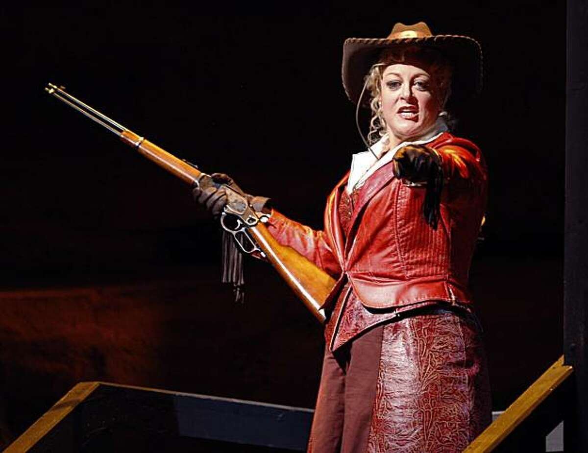 Deborah Voight is armed with a rifle in a scene from the San Francisco Opera's production of Puccini's