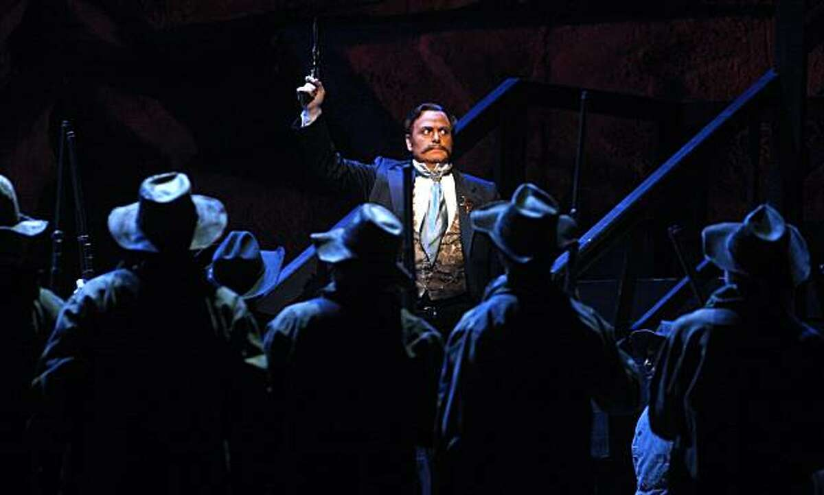 Sheriff Rance, portrayed by Roberto Frontali, organizes a posse to capture outlaws in a scene from the San Francisco Opera's production of Puccini's
