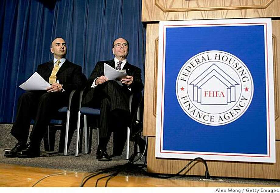 WASHINGTON - NOVEMBER 11:  Interim Assistant Treasury Secretary for Financial Stability Neel Kashkari (L) and Federal Housing Financial Agency Director James Lockhart (R) listen during a news conference at the Federal Housing Finance Agency November 11, 2008 in Washington, DC. A plan with a simplifier loan modification system and designed to reduce foreclosures was introduced at the news conference. Officials said the program will help struggle homeowners to mortgages that they can afford.  (Photo by Alex Wong/Getty Images) Photo: Alex Wong, Getty Images