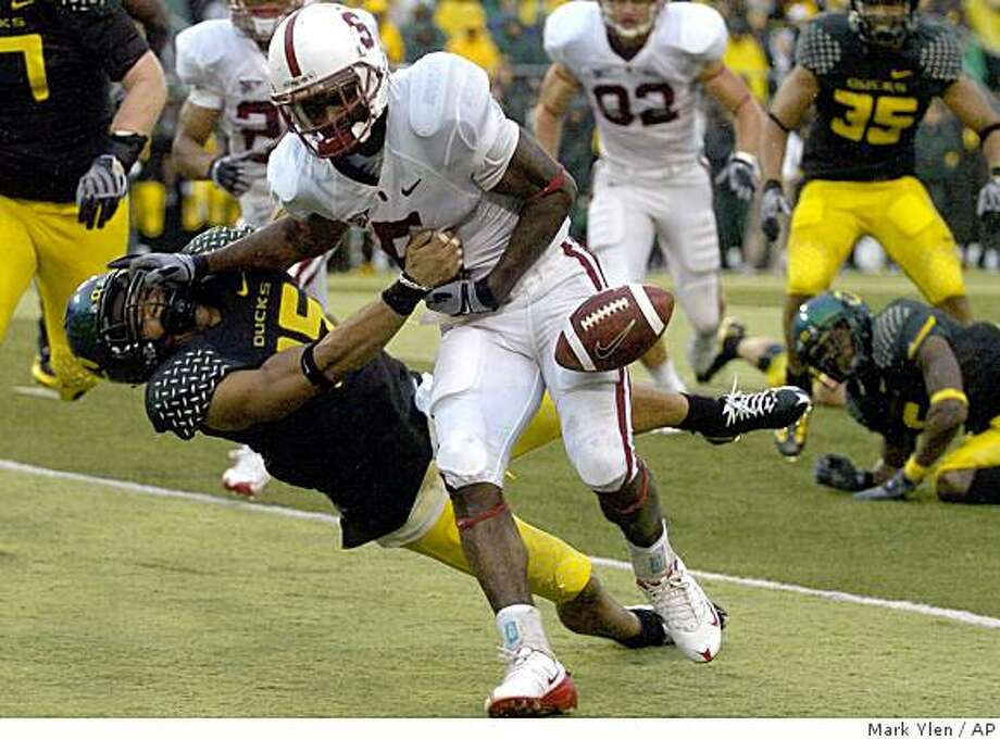 Stanford's Anthony Kimble fumbles the ball inside the five yard line while being tackled by Oregon's Patrick Chung during a  NCAA college football in Eugene, Ore., Saturday Oct. 8, 2008. Oregon beat Stanford 35-28. (AP Photo/Albany Demcorat-Herald, Mark Ylen) Photo: Mark Ylen, AP