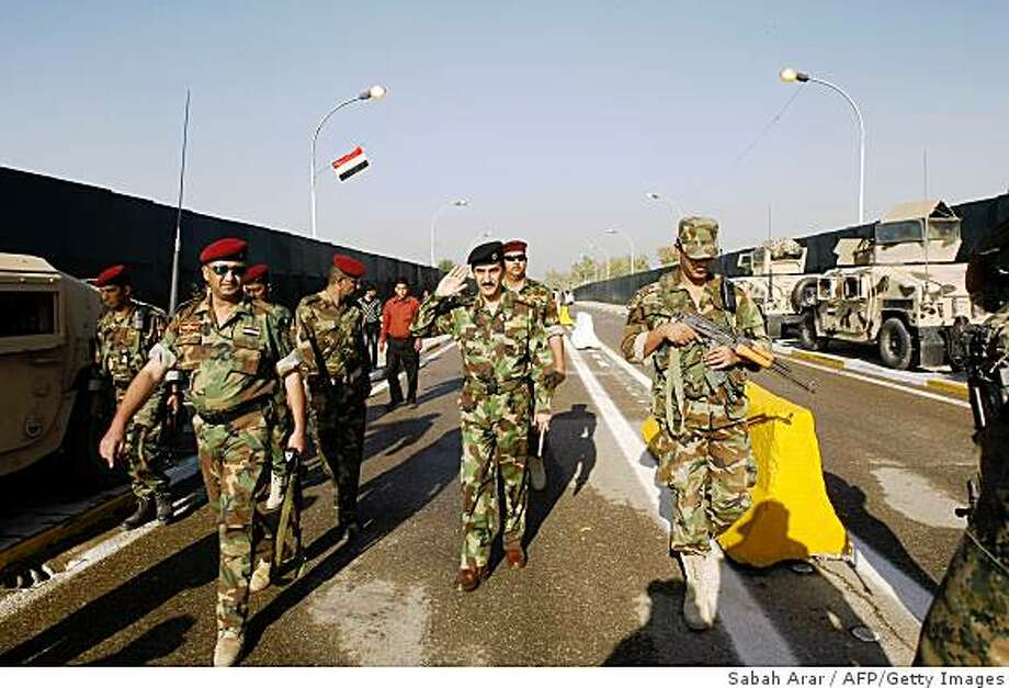Iraqi Major General Qassim Atta walks from the Kadhimiyah district of the capital across the Al-Aima bridge which spans the Tigris River linking the centuries-old neighbourhoods of Kadhimiyah and Adhamiyah, the former named for a revered Shiite shrine and the latter built around the tomb of a famed Sunni lawmaker on November 11, 2008, in Baghdad. Authorities in Baghdad opened the bridge linking historic Sunni and Shiite districts that was closed in 2005 after nearly 1,000 Shiite pilgrims perished in a deadly stampede. AFP PHOTO/ SABAH ARAR (Photo credit should read SABAH ARAR/AFP/Getty Images) Photo: Sabah Arar, AFP/Getty Images