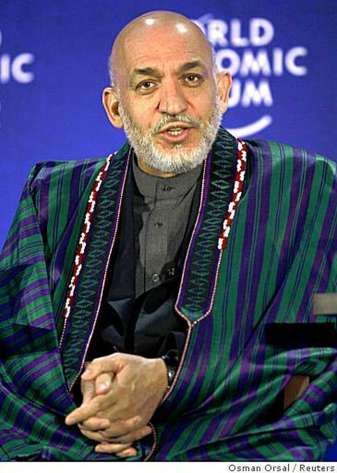 Afghanistan's President Hamid Karzai speaks during The World Economic Forum's (WEF) Turkey summit in Istanbul October 31, 2008. REUTERS/Osman Orsal   (TURKEY) Photo: Osman Orsal, Reuters