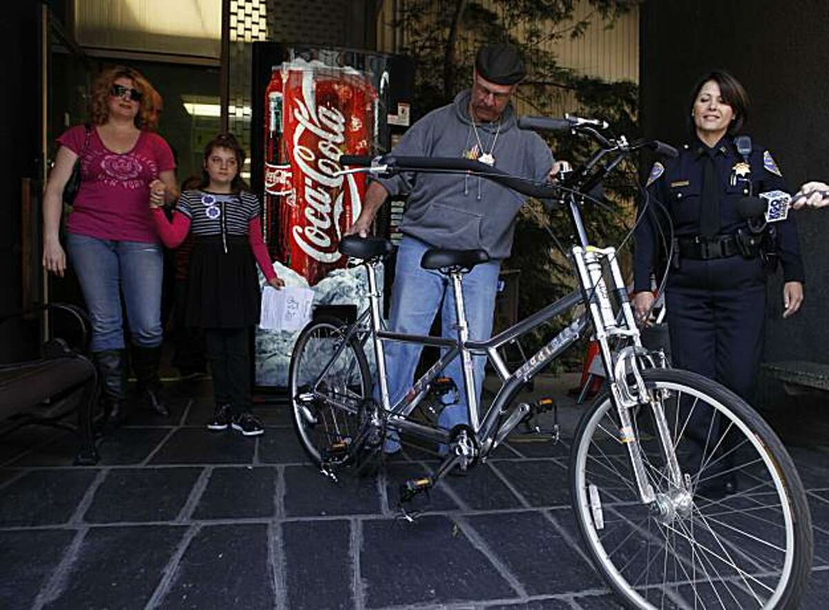 After her bike was stolen and then found by SFPD, Rachel Hoffman, 9, escorted by her mother Geri Camp, meet with members or the press at Central Station on Wednesday June 9, 2010 in San Francisco, Calif. Rachel has a autism and the recovered bike is specially design to be ridden with a parent. Suspects are still at large. Holding the bike is the Sgt. Carl T the lead investigator on the stolen bike case and to his right is Captain Anna Brown.