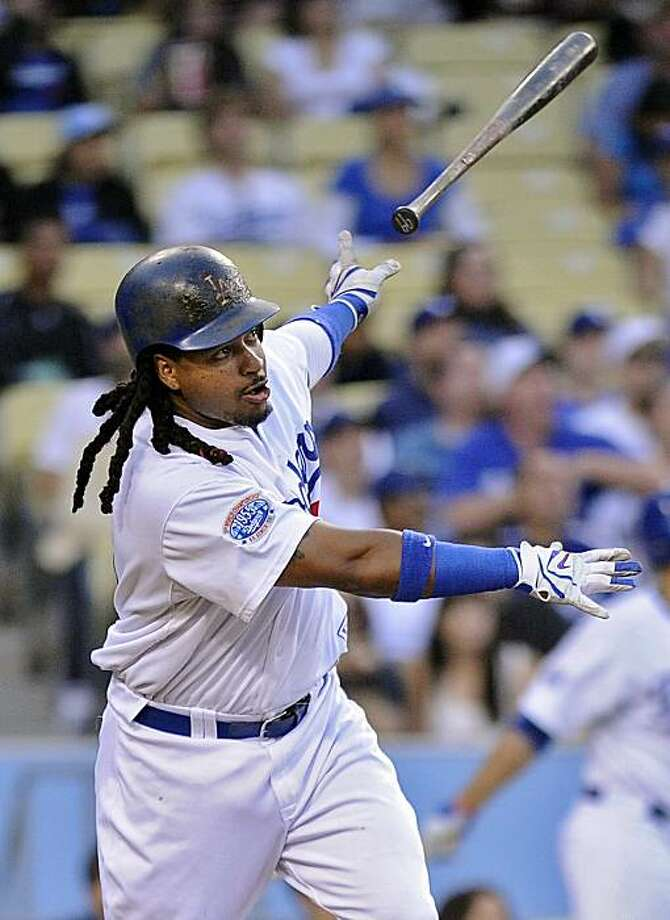 Los Angeles Dodgers Manny Ramirez tosses his bat after hitting a two-run home run during the first inning of a baseball game against the St. Louis Cardinals, Wednesday, June 9, 2010, in Los Angeles. Photo: Mark J. Terrill, AP