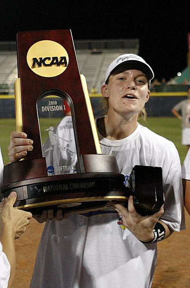 UCLA's Megan Langenfeld holds the championship trophy after UCLA defeated Arizona 15-9 to win the NCAA softball World Series in Oklahoma City, Tuesday, June 8, 2010. Photo: Alonzo Adams, AP