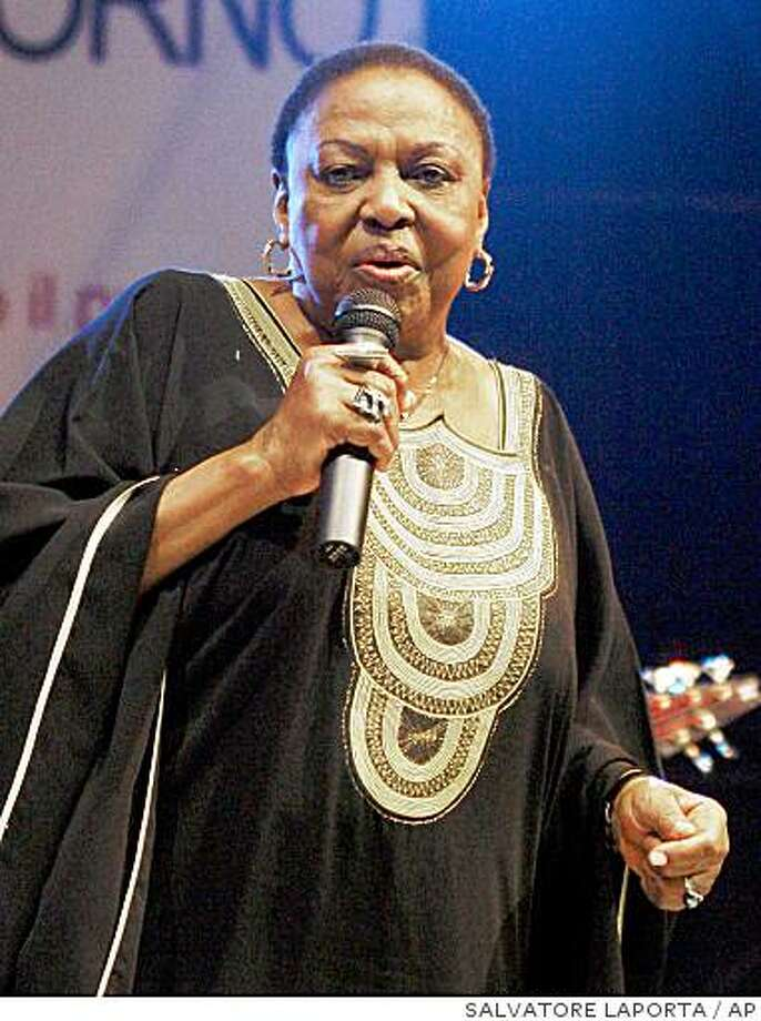 Miriam Makeba, the South African singer known to fans worldwide as Mama Africa, performs during her last concert in Castel Volturno, southern Italy, late Sunday night, Nov. 9, 2008. According to the Pineta Grande clinic in Castel Volturno Makeba died of a heart attack, after collapsing during her concert. She was 76. (AP Photo/Salvatore Laporta) Photo: SALVATORE LAPORTA, AP