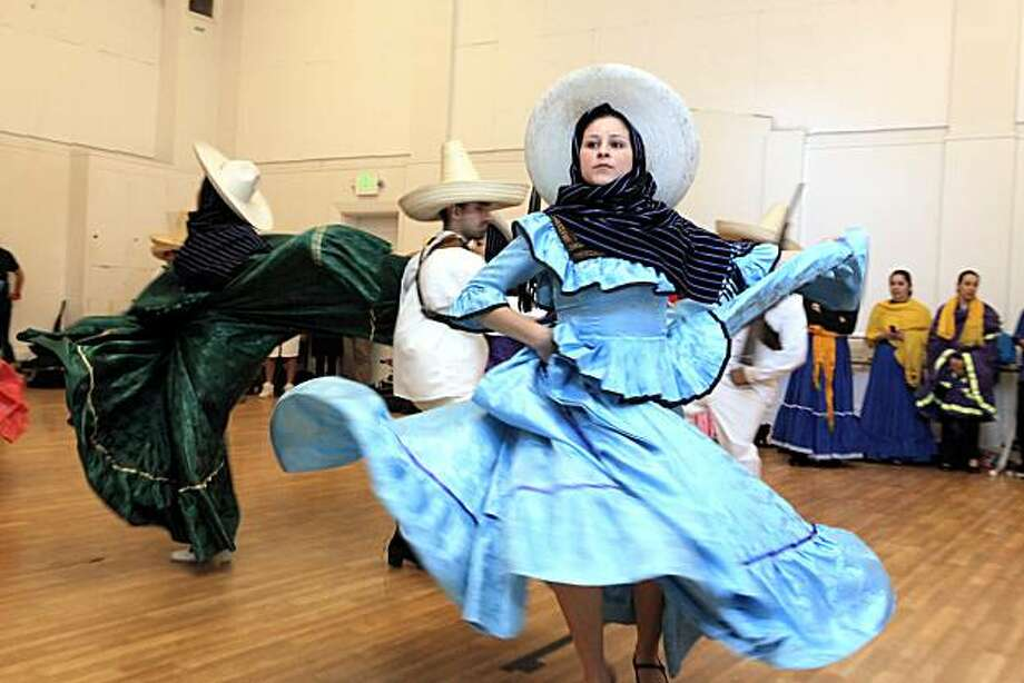 Members of the dance group Ensembles Ballet Folklorico de San Francisco practice a piece by choreographer, Zenon Barron, at the San Francisco Dance Center in San Francisco, Calif., on Sunday, May 23, 2010. The piece shows in dance, the events of the Mexican Revolution. Photo: Carlos Avila Gonzalez, The Chronicle