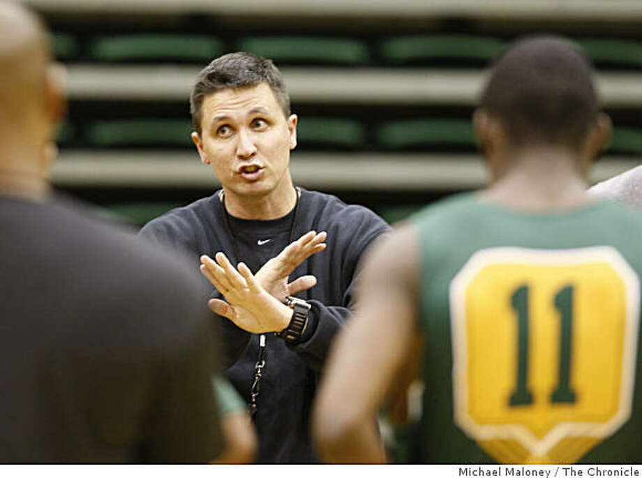 USF basketball coach Rex Walters  leads his team through practice at the War Memorial Gym on the University of San Francisco campus in San Francisco, Calif., on  October 30, 2008. Photo: Michael Maloney, The Chronicle