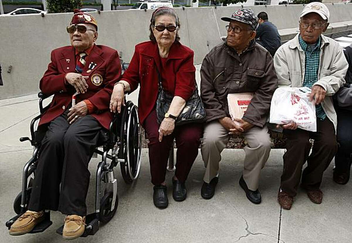 Left to right--plaintiff Romeo R. de Fernandez with his wife Natividad de Fernandez, plaintiff Ciriaco C. dela Cruz, 84 years old, and plaintiff Valeriano C. Marcelino, 88 years old at a press conference to announce a lawsuit by Filipino veterans of World War II seeking benefits from the U.S. government in front of the federal building in San Francisco, Calif., on Friday, June 4, 2010.