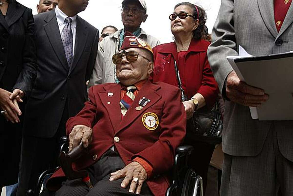 Plaintiff Romeo R. de Fernandez (wheelchair, middle) with his wife Natividad de Fernandez at a press conference to announce a lawsuit by Filipino veterans of World War II seeking benefits from the U.S. government in front of the federal building in San Francisco, Calif., on Friday, June 4, 2010. Left of Natividad is plaintiff Valeriano C. Marcelino, 88 years old.