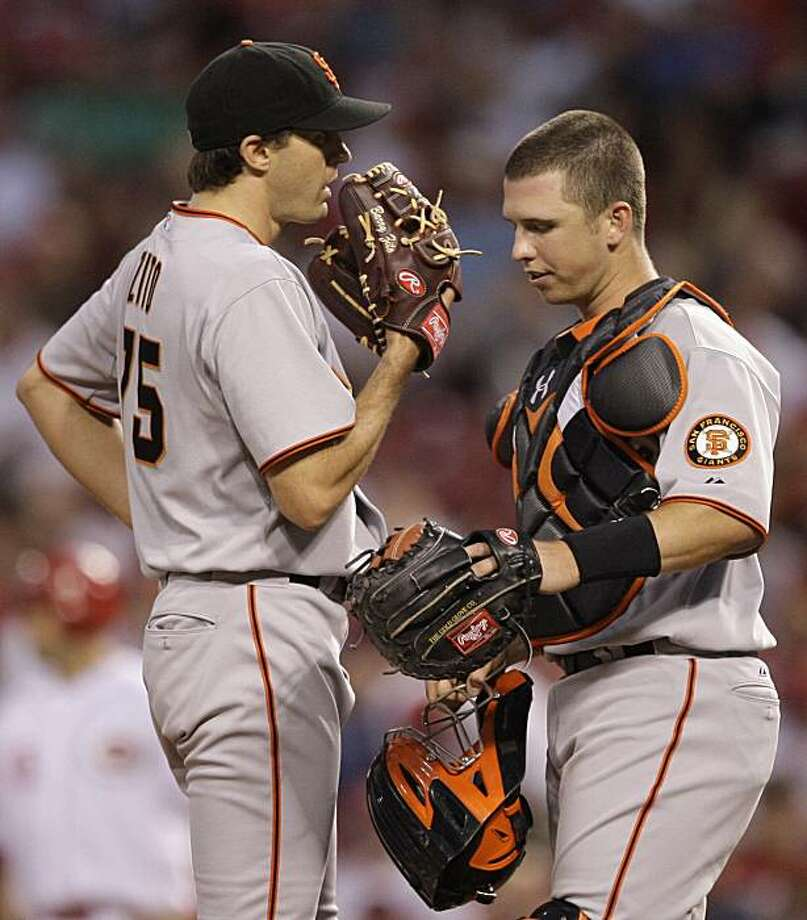 San Francisco Giants catcher Buster Posey talks with starting pitcher Barry Zito (75) in the sixth inning of a baseball game against the Cincinnati Reds, Monday, June 7, 2010, in Cincinnati. Posey was making his first start as a catcher for the giants. San Francisco won the game 6-5. Photo: Al Behrman, AP