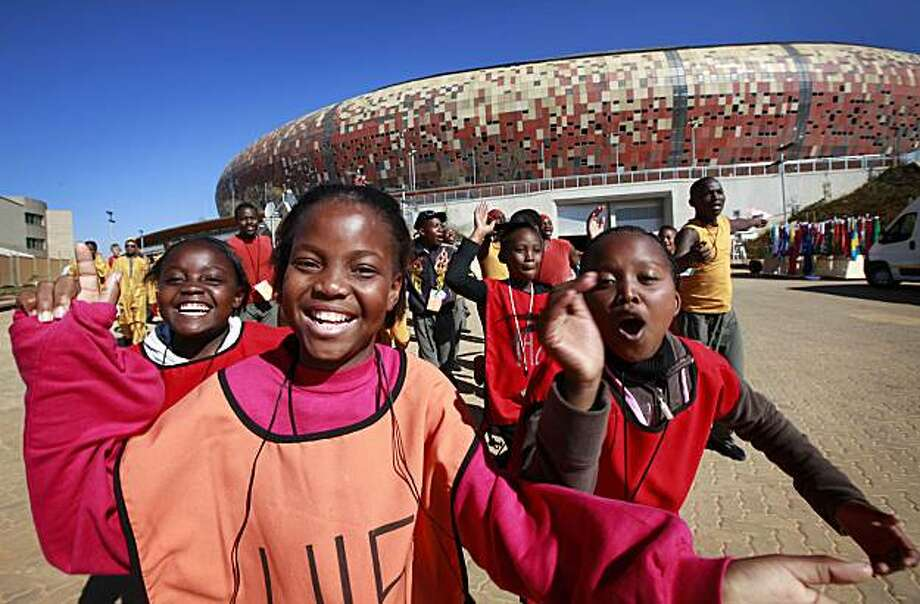 South African children, part of the cast for the opening ceremony of the 2010 World Cup Soccer, sing as they arrive  at Soccer City stadium for a dress rehearsal in Johannesburg Wednesday June 9, 2010.  . The first soccer World Cup to be played in Africais set to kick-off on June 11AP Photo/Jerome Delay) Photo: Jerome Delay, AP