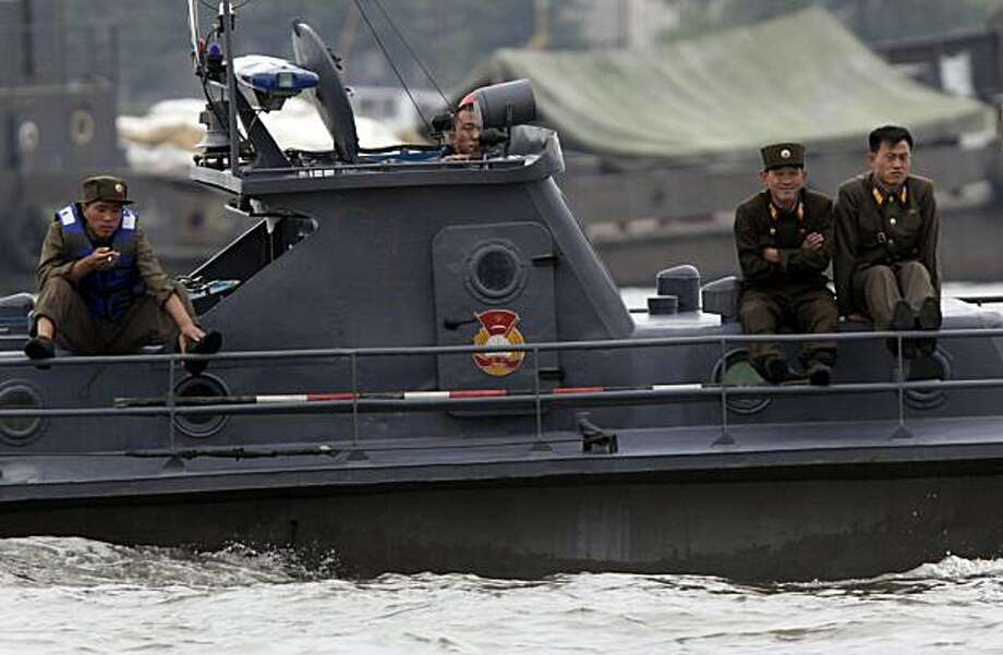 North Korean soldiers on a North Korean patrol boat as seen along the Yalu river near Dandong in northeastern China's Liaoning province on Saturday, May 29, 2010. Top South Korean military commanders in Seoul discuss how to counter North Korean provocations as the leaders of South Korea, China and Japan head to the South Korean southern island of Jeju for a summit expected to focus on the sinking of a warship blamed on North Korea. Photo: Ng Han Guan, Associated Press