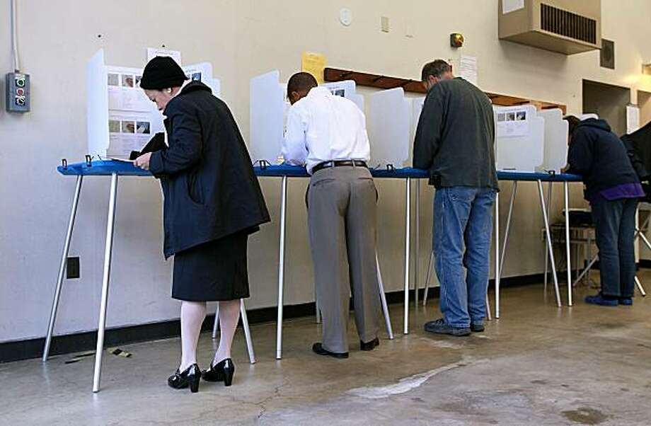 OAKLAND, CA - JUNE 08:  Voters fill out ballots at a polling place in a fire station June 8, 2010 in Oakland, California. California voters are heading to the polls to vote in the primary elections for governor, U.S. senate and other statewide and local races. Photo: Justin Sullivan, Getty Images