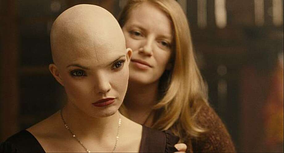 "In this film publicity image released by Warner Bros., Delphine Chaneac, left, and Sarah Polley are shown in a scene from ""Splice."" Photo: Warner Bros. Pictures, AP"