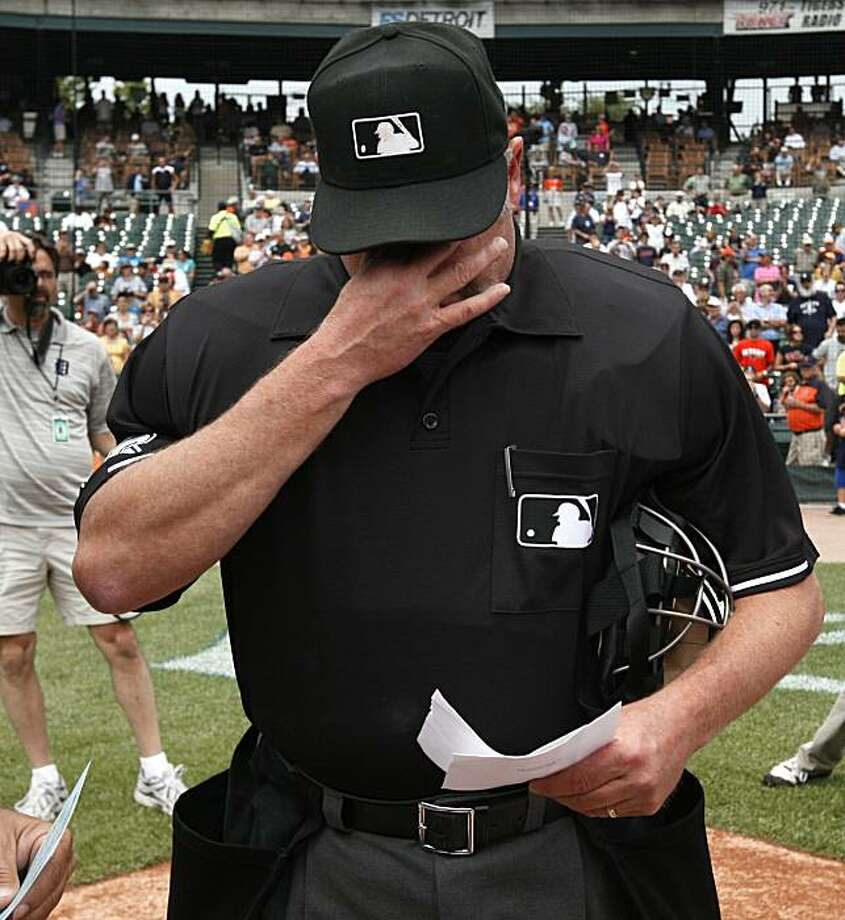 Home plate umpire Jim Joyce wipes tears during the exchange of lineup cards before the Cleveland Indians-Detroit Tigers before a  baseball game in Detroit, Thursday, June 3, 2010. Tigers pitcher Armando Galarraga lost his bid for a perfect game with two outs in the ninth inning on a disputed call  at first base by Joyce on Tuesday night. Photo: Paul Sancya, AP
