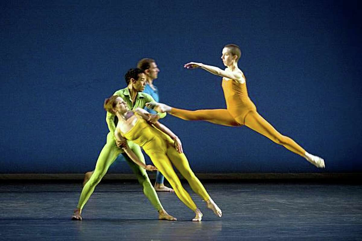 Merce Cunningham Dance Company dancer Daniel Madoff (blue), Rashaum Mitchell (green), Holley Farmer (yellow) and Julie Cunningham (orange) perform in the first act, Suite for Five at Zellerbach Hall, UC Berkeley in Berkeley, California on Nov. 7, 2008.
