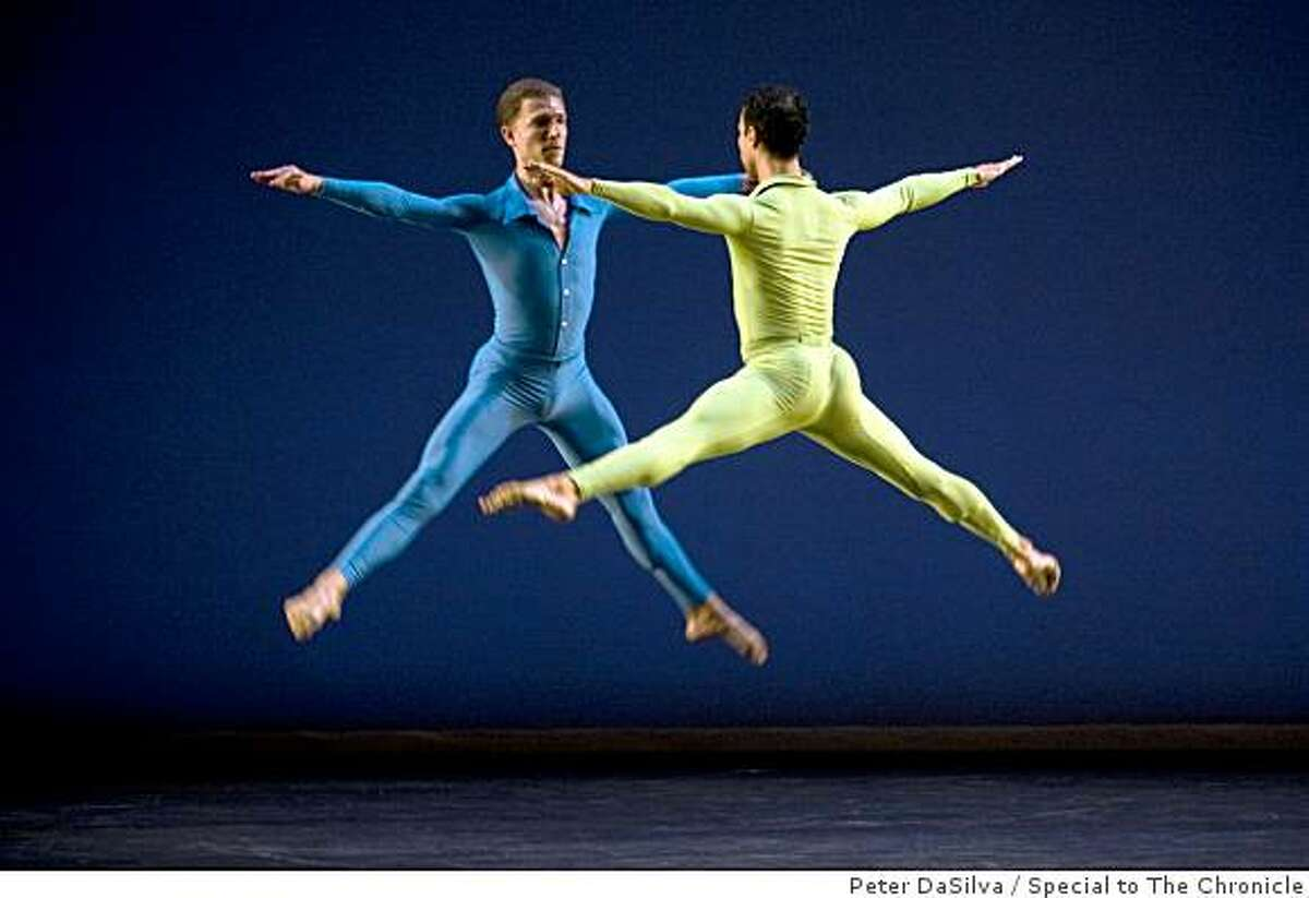 Merce Cunningham Dance Company dancer Daniel Madoff (blue) & Rashaum Mitchell (green) perform in the first act, Suite for Five at Zellerbach Hall, UC Berkeley in Berkeley, California on Nov. 7, 2008.