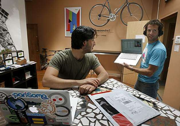 Julian Nachtigal (left) works at the kitchen counter while his business partner Clement Alteresco carries his laptop while video conferencing at the PariSoma innovation loft in San Francisco, Calif., on Thursday, June 3, 2010. Photo: Paul Chinn, The Chronicle