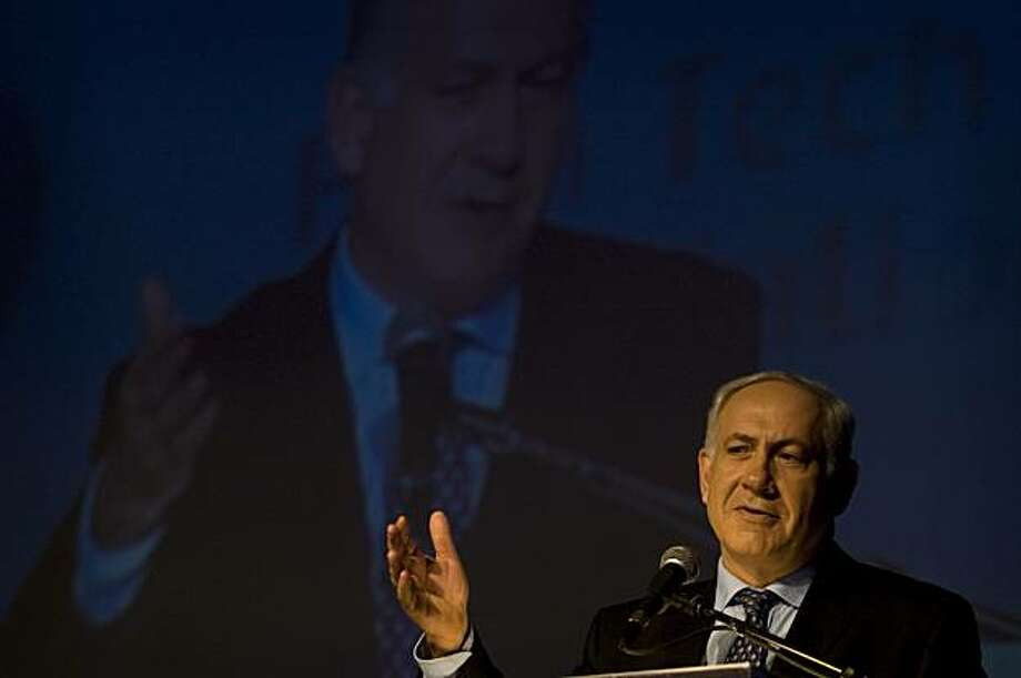 Israeli Prime Minister Benjamin Netanyahu gestures as he speaks at a technology conference in Jerusalem, Tuesday, June 8, 2010. The Israeli military said Tuesday it has set up an internal team of experts to examine its deadly raid on a Gaza-bound flotilla, while the government sought a formula for a broader probe that would defuse mounting international calls for an impartial investigation. Photo: Sebastian Scheiner, Associated Press