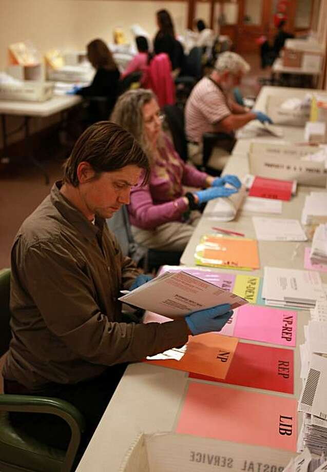 Vote by mail ballots being manually sorted by Daniel Libby at the department of elections ballot distribution staff today at City Hall in San Francisco, Calif., on Monday, June 7, 2010. Photo: Liz Hafalia, The Chronicle