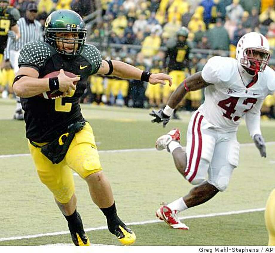 Oregon's quarterback Jeremiah Masoli (2) runs against Stanford's Chike Amajoy (43) during the final minutes of  an NCAA college football in Eugene, Ore., Saturday Oct. 8, 2008. Oregon beat Stanford 35-28. (AP Photo/Greg Wahl-Stephens) Photo: Greg Wahl-Stephens, AP