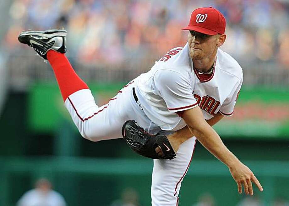 Washington Nationals starting pitcher Stephen Strasburg follows through on a pitch to Pittsburgh Pirates batter Garrett Jones during the second inning at Nationals Park in Washington, D.C. Tuesday, June 8, 2010. (Chuck Myers/MCT) Photo: Chuck Myers, MCT