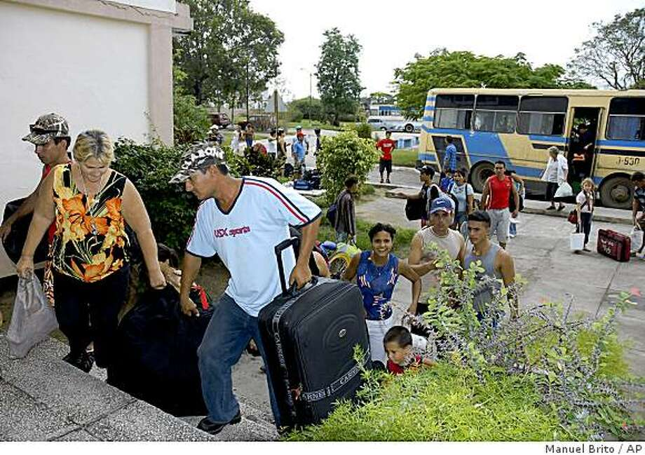 Evacuees arrive at a shelter before the arrival of Hurricane Paloma in Sancti Spiritus, Cuba, on Saturday. Photo: Manuel Brito, AP