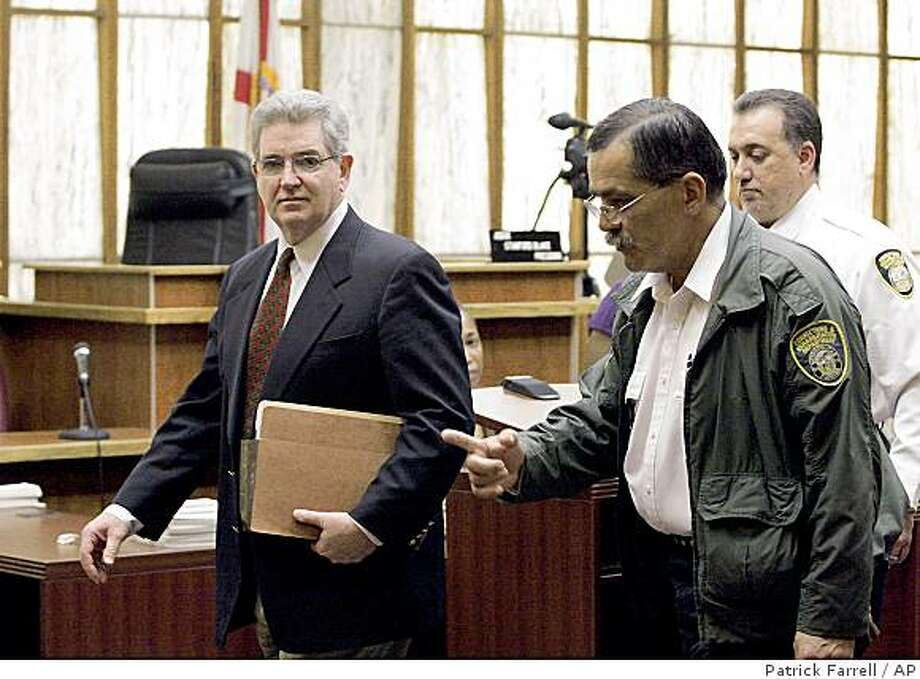 Former FBI agent John Connolly, left,  is led out of court by court officers after hearing the verdict, Thursday, Nov. 6, 2008 in Miami. Former FBI agent John Connolly was convicted Thursday of second-degree murder for leaking information to Boston mobsters that led to the 1982 shooting death of a gambling executive who also had ties to gangsters.(AP Photo/Patrick Farrell, Pool)**NO SALES, MAGS OUT** Photo: Patrick Farrell, AP