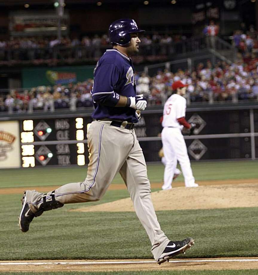 San Diego Padres' Adrian Gonzalez runs home after he hit a solo home run against the Philadelphia Phillies in the seventh inning of a baseball game Monday, June 7, 2010, in Philadelphia. The Padres won 3-1. Photo: H. Rumph Jr, AP