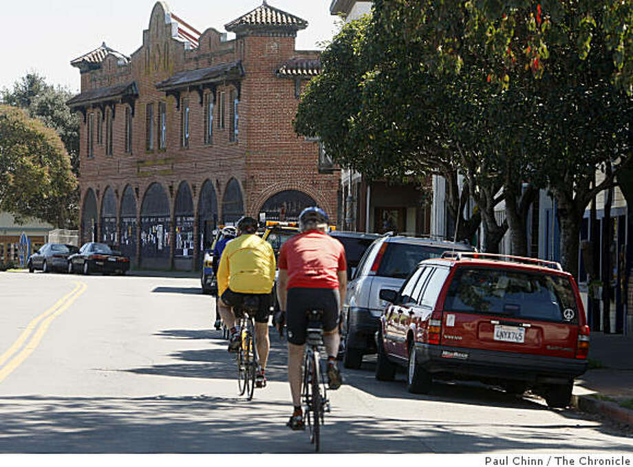 "Bicyclists ride down Highway 1 which cuts through downtown Point Reyes Station, Calif., on Wednesday, March 5, 2008. The tiny  West Marin town will host, ""Geography of Hope,"" a three-day literary festival celebrating the work of famed author Wallace Stegner.Photo by Paul Chinn / San Francisco Chronicle Photo: Paul Chinn, The Chronicle"