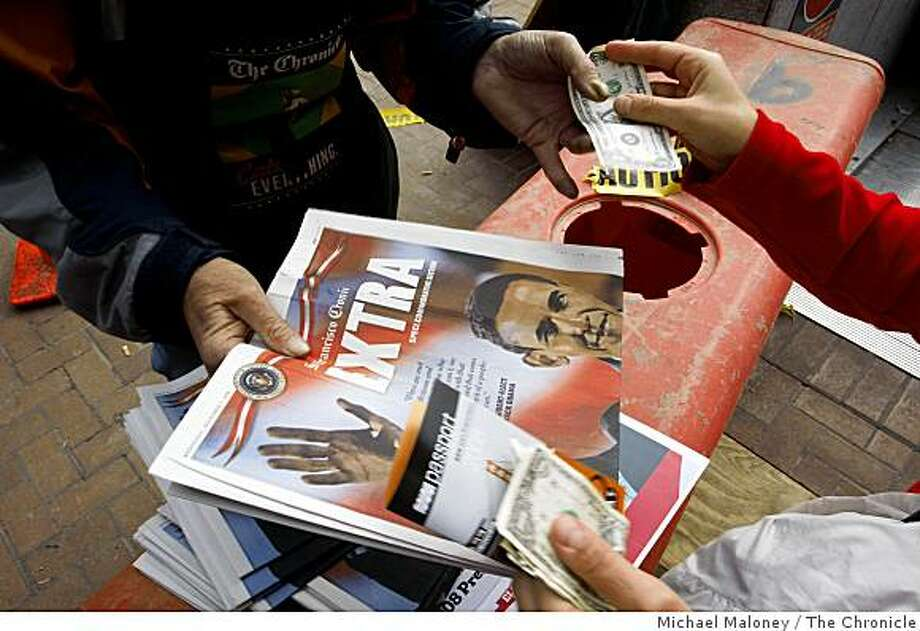 Clyde Conrad, left, a vendor for the Chronicle sold 150 commemorative special editions in 30 minutes at the Powell Street Bart Station. Readers found empty news racks in San Francisco, Calif., on November 5, 2008 due to the historic election results Tuesday night. The Chronicle printed commemorative special editions for a dollar a piece that were also selling out quickly. Photo: Michael Maloney, The Chronicle