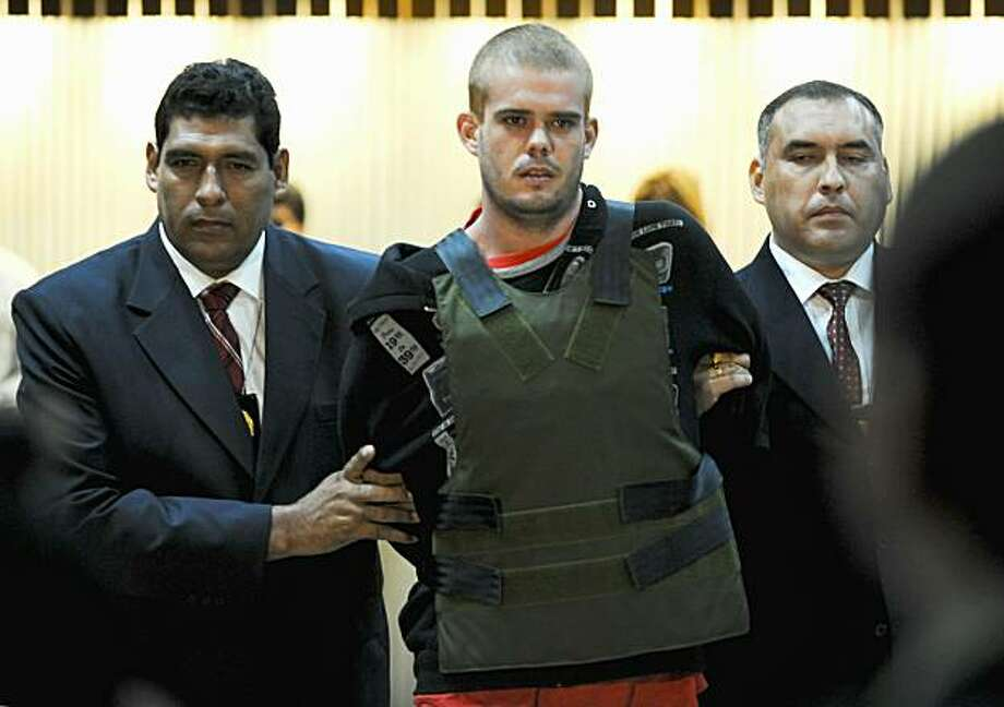 Joran Andreas Petrus van der Sloot (C), is escorted by Peruvian police as he arrive to the DIRINCRI (Criminal Investigation Direction) offices in Lima on June 5, 2010. Peruvian police had been searching for van der Sloot - the main suspect in the killingof Stephany Flores Ramirez, 21, the daughter of Peruvian businessman and race car driver Ricardo Flores Chipoco - who was stopped in a taxi in Chile after entering the country from Peru last May 31. Photo: Ernesto Benavides, AFP/Getty Images