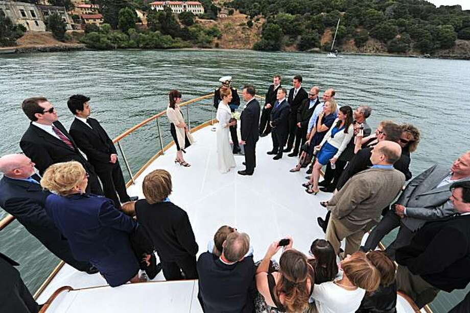 "Patty Mueller and Joe Inkenbrandt celebrate their wedding aboard the SF Bay Adventures charter boat, ""Just Dreaming,"" on September 13, 2009 on the bay. Photo: Jason Bennett, Bennett Weddings"