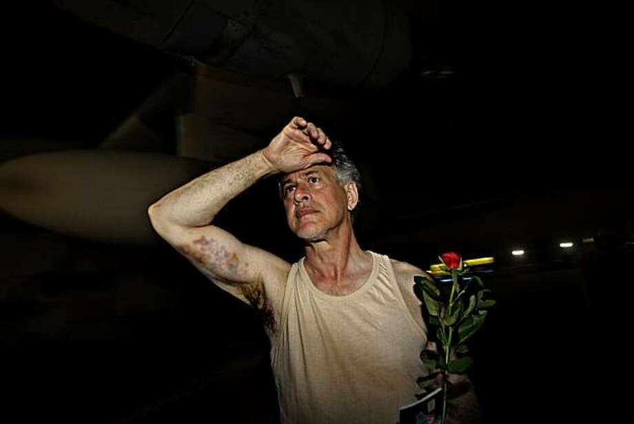 U.S. activist, Paul Larudee, 64, of Calif. after a plane carrying 35 activists from the Gaza flotilla arrived at the Elefsina military airport near Athens early Thursday, May 3, 2010. Larudee, who bore evident signs of bruising, said he was beaten after refusing to sign papers demanded by Israeli officials. The military transport brought 31 Greeks, 3 French and one U.S. national released by Israeli authorities, the air force said. They were welcomed by dozens of relatives  and supporters, after a nearly three-hour flight. Six more Greeks reached Athens on Tuesday. Photo: Petros Giannakouris, AP