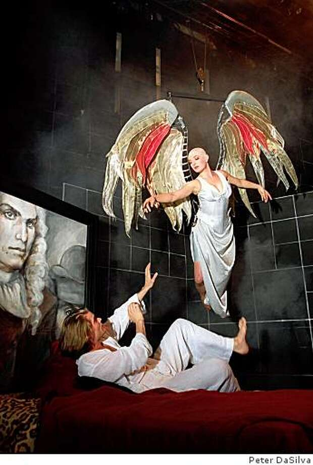 "Actress Lise Bruneau as the angel, flys in over Garret Dillahunt, who plays Prior Walker, in the 1994 play ""Angels in America"" Photo: Peter DaSilva"