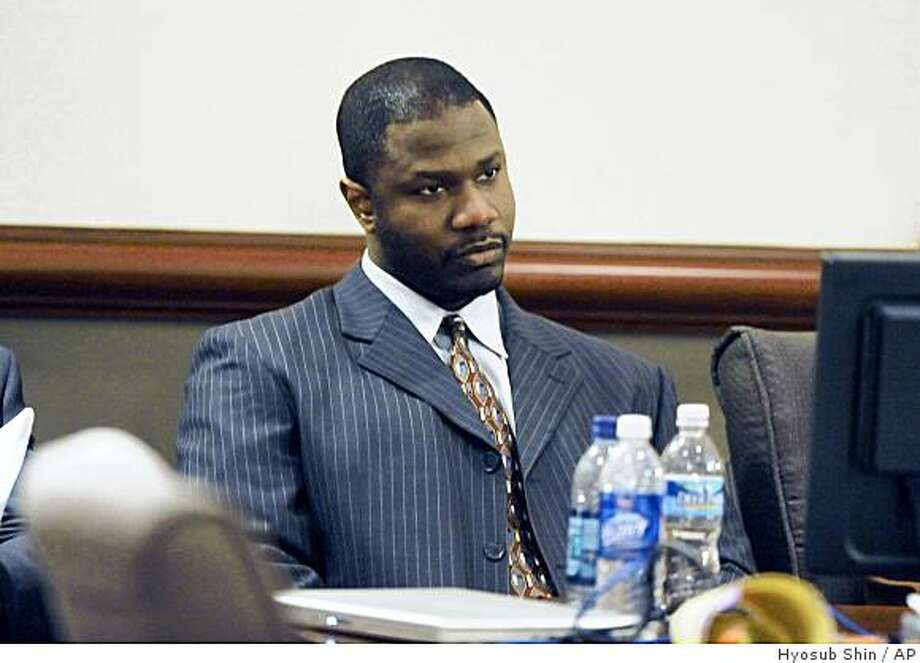 Brian Nichols listens as a verdict against him is read in court Friday, Nov.7, 2008, in Atlanta. Nichols, who launched a deadly courthouse shooting spree during his rape trial, killing a judge and three others, was convicted of murder by a jury Friday more than three years after he turned the city's seat of justice into a crime scene.(AP Photo/Hyosub Shin pool) Photo: Hyosub Shin, AP