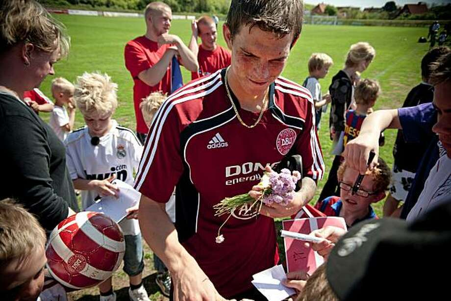 Daniel Agger of Liverpool FC and member of the Danish World Cup squad, sign autographs in Skagen, the top of Denmark, Saturday, May 22, 2010. The Danish squad has moved it's camp to the North of Denmark, in the village of Skagen for two days to meet their fans. Photo: Rumle Skafte, AP