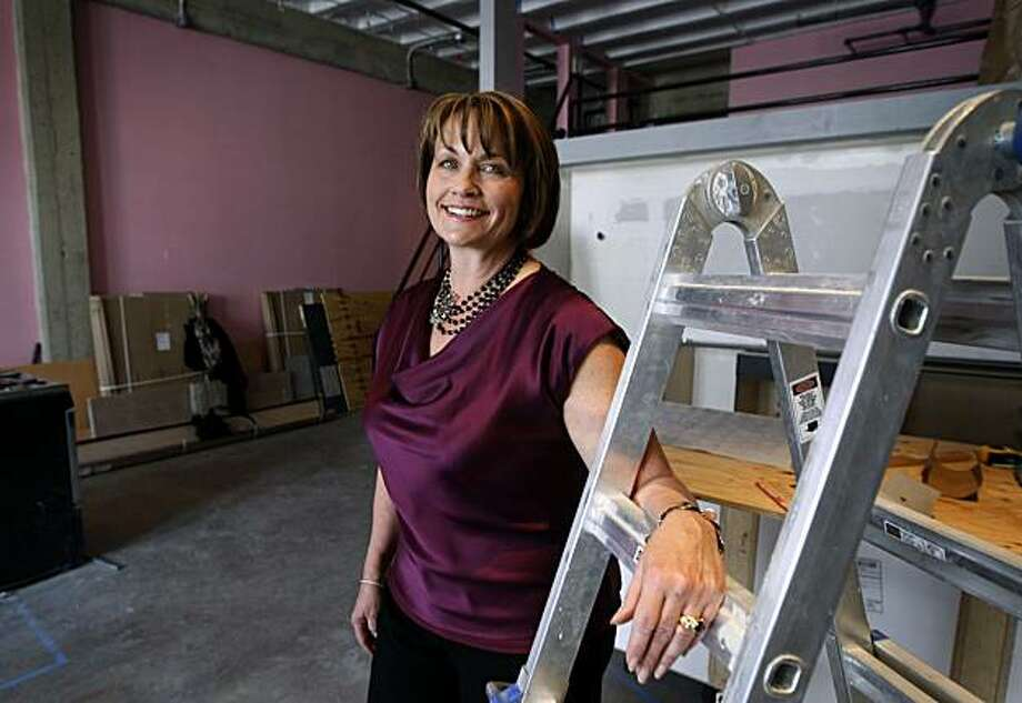 Interior designer Kristina Wolf works at a client's loft in Oakland, Calif., on Wednesday, May 5, 2010. Wolf is a former Oakland Police lieutenant who started her own design firm two years ago after retiring from the police force. Photo: Paul Chinn, The Chronicle