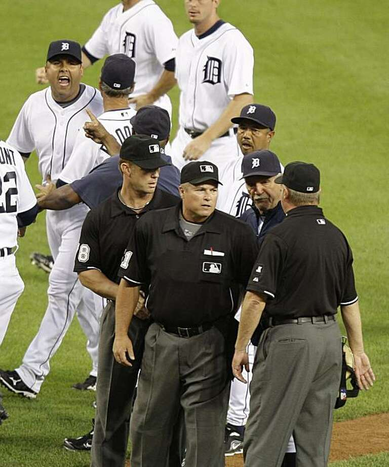 Detroit Tigers catcher Gerald Laird, upper left, shouts towards umpires as Tigers manager Jim Leyland, second from right foreground, talks with umpires during a baseball game against the Cleveland Indians, Wednesday June 2, 2010, in Detroit. At right foreground is umpire Jim Joyce. Armando Galarraga bitterly sipped a beer minutes after he almost pitched a perfect game, lashing out at first base umpire Jim Joyce for blowing a call that negated his place in baseball history. An apology and hug changed Galarraga's attitude. Photo: Julian H. Gonzalez, AP
