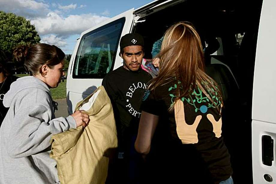 After On the Move established a new community center to give the Latino kids in Napa a place to go, to engage in the community in a positive way. At McPherson Elementary School, student Eric Cruz (center) and other students of LAYLA, a program of the nonprofit agency On The Move, get ready to go camping as part of a retreat on Friday, May 21, 2010 in Napa Valley, Calif. Photo: Jessica Pons, The Chronicle
