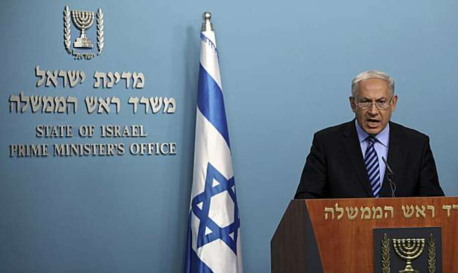 Israeli Prime Minister Benjamin Netanyahu delivers a statement concerning the Israeli naval commando raid on a flotilla attempting to break the blockade on Gaza, at his Jerusalem office, Wednesday, June 2, 2010. In an attempt to limit the diplomatic damage from its deadly raid on a Gaza-bound aid flotilla, Israel dropped plans Wednesday to prosecute dozens of pro-Palestinian activists, opting instead to deport them all immediately. Photo: Jim Hollander, AP