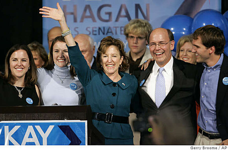 Senator-elect Kay Hagan, D-N.C., center, celebrates with her family at her election party in Greensboro, N.C., Tuesday, Nov. 4, 2008. At left are daughters Jeanette and Carrie, and at right are husband Chip and son Tilden. (AP Photo/Gerry Broome) Photo: Gerry Broome, AP